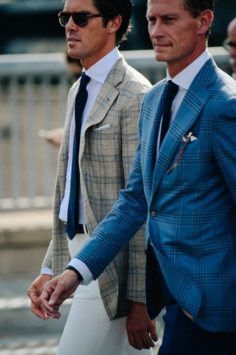 Two men wearing check suits